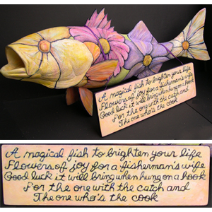 """In 2011, the Cultural Center of Cape Cod asked 25 Cape artists to transform a 34-inch fiberglass striped bass into their own work of art. Kathi wrote this poem and created her """"Magical Fish"""". After being on display at various Cape Cod locations, the fish were auctioned and close to $20,000 was raised for the new educational wing of the Cultural Center of Cape Cod."""